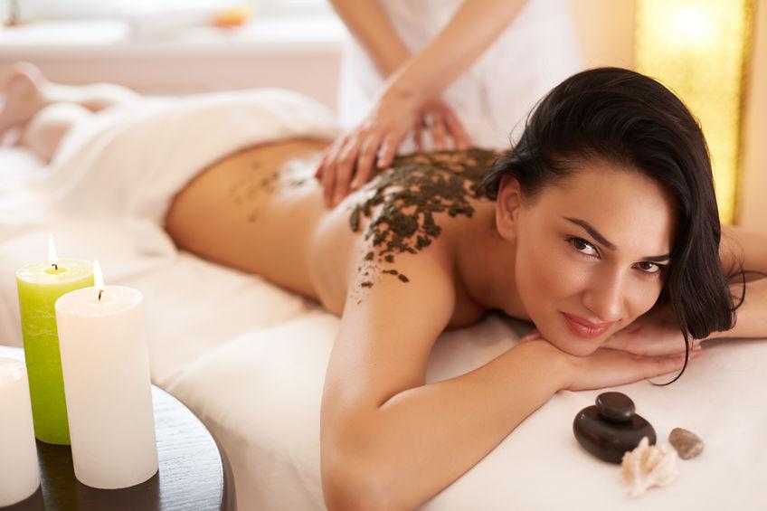 45743626 - spa woman. brunette getting a marine algae wrap treatment in spa salon