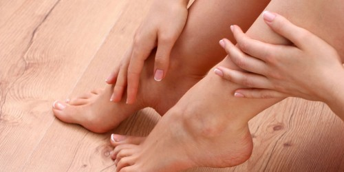 44072180 - closeup photo of a beautiful female feet with red pedicure isolated on white.